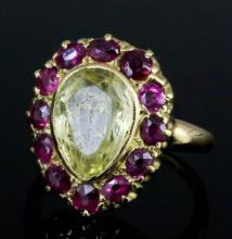 A late Victorian 18ct gold mounted citrine and ruby heart pattern ring, the tear drop shaped citrine