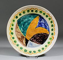 Duncan Grant (1885-1978) - A lead glazed pottery dish brightly painted in colours with an abstract d