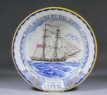 A large Poole pottery dish, the centre with a design by Arthur Bradbury of The Sloop