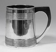 A George III silver tankard the tapered body with