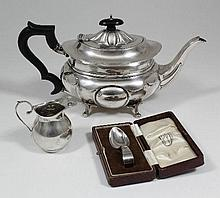 A George V silver rectangular teapot with fluted
