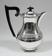 A George V silver oval coffee pot with gadroon