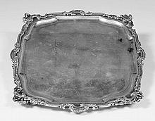 An Edward VII silver square salver with leaf cast