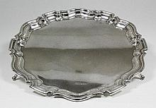 A George V silver salver with shaped and moulded