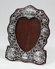 An Edward VII silver photograph frame of shaped