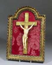 A 19th Century French carved ivory Corpus Christi mounted on gilt crucifix, 11ins high, in a gilt fr