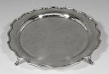 A George VI silver circular salver with shaped rim