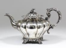 A William IV silver teapot with squat lobed circular body, conforming lid w