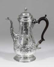 A George III silver baluster shaped coffee pot, the domed cover with spiral