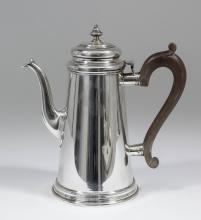 An Elizabeth II silver cylindrical coffee pot of 18th Century design and of