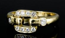 A modern Cartier 18ct gold diamond set ring, the open oblong face set with