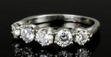 A modern 18ct white gold mounted five stone diamond ring, the graduated bri