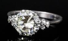 A modern 18ct white gold mounted solitaire diamond ring, the brilliant cut