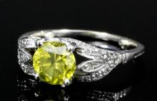 A modern 18ct white gold mounted yellow diamond solitaire ring, the brillia