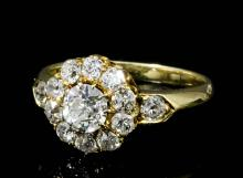 An Edwardian 18ct gold mounted all diamond set cluster ring, the central ol