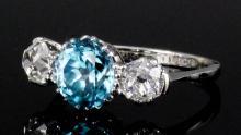 A modern 18ct white gold mounted aquamarine and diamond three stone ring, t