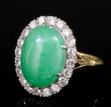 A modern 18ct gold and platinum mounted jade and diamond ring, the central
