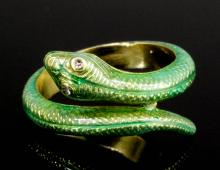 A modern 18ct gold and green enamel serpent pattern ring with rose diamond