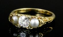 A late Victorian gold coloured metal mounted diamond and pearl three stone