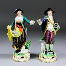 A pair of early 19th Century Derby porcelain figures of a fine gentleman an