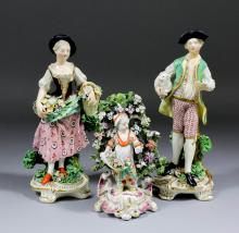 A pair of early 19th Century Derby figures of a couple in country dress, he