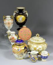 An early 20th Century Royal Crown Derby bone china two-handled vase painted