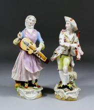 A pair of late 19th Century Meissen porcelain figures of musicians in 18th