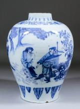 A late 17th Century Delft blue and white baluster shaped vase decorated in