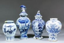 A late 18th Century Delft blue and white moulded vase and cover, the sides