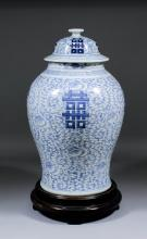 A Chinese blue and white porcelain baluster shaped vase and cover, painted