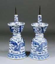 A pair of Chinese blue and white porcelain pricket candlesticks, both of do