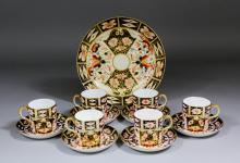 Six Royal Crown Derby bone china coffee cans and saucers painted and gilded