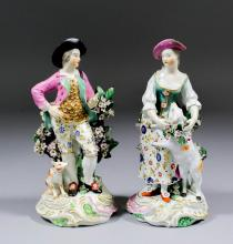 A pair of 18th Century Derby porcelain figures of a male figure and his com