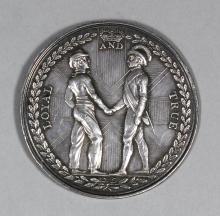 A George III silver medallion -