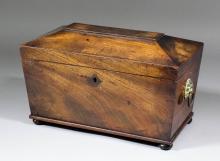 A George III mahogany rectangular tea caddy of sarcophagus shape, the inter
