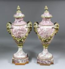 A pair of late 19th/early 20th Century French mauve veined marble and gilt