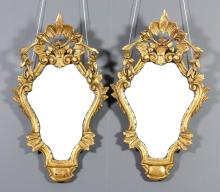 A pair of Italian Venetian style giltwood framed wall mirrors of shaped and