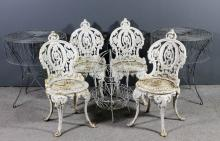 A set of four 19th Century French white painted cast iron garden chairs wit