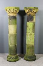 A pair of stone cylindrical garden pedestals in the medieval manner, the oc