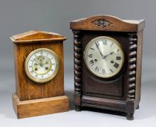 A late 19th Century French oak cased mantel clock, the 3.75ins diameter whi