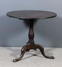 A George III mahogany circular tripod occasional table on turned baluster c