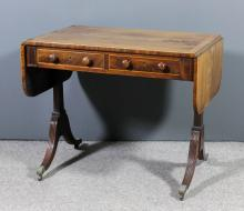 A George III mahogany sofa table with D-shaped flaps, the top banded in ros