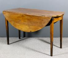 A 19th Century French cherrywood circular drop-leaf dining table, on square