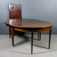 A George III mahogany D-end extending dining table and two extra leaves for
