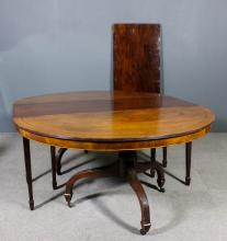 A 19th Century mahogany extending dining table inlaid with ebony stringings