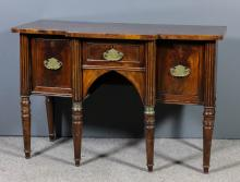 A mahogany break-front sideboard of William IV deign with plain top, fitted