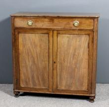 A late Georgian mahogany chiffonier base with rounded front corners, reeded