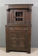 An old panelled oak court cupboard of