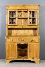 A stripped pine dresser of Victorian design, the upper part with moulded co