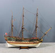A painted wood model of a three masted galleon, 40ins long x 36ins high, an
